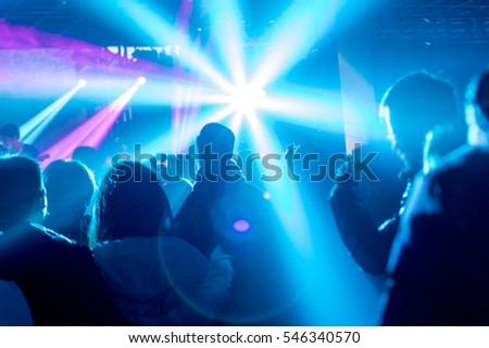 Rock stage, light and enthusiastic audience