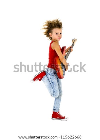 Rock star kid  dances with electric guitar - stock photo