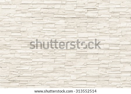 Rock stone brick tile wall aged texture detailed pattern background in cream beige brown color tone: Grunge ancient rustic limestone patterned backdrop for decoration in creme brown toned colour    - stock photo