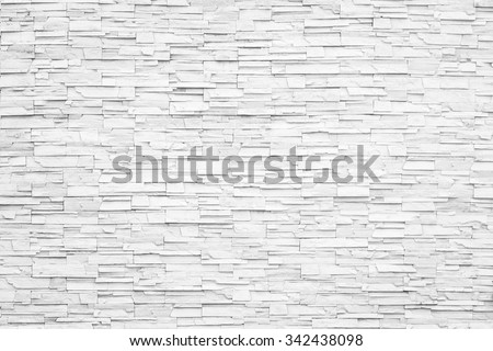 Rock stone brick tile wall aged texture detailed pattern background in white grey color tone: Grunge ancient rustic limestone patterned backdrop for decoration in gray toned colour  - stock photo