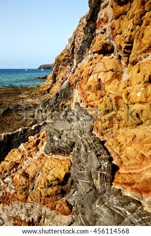rock stone sky cloud beach  water  coastline and summer in lanzarote spain - stock photo