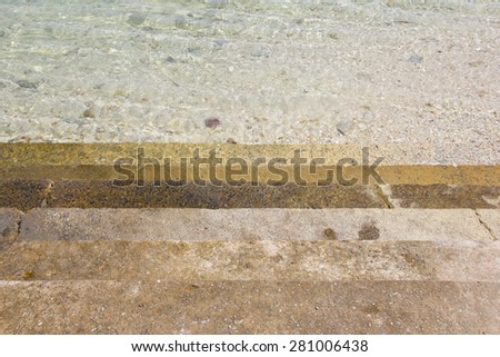 Rock stone stair with blue green sea ocean can be used as background texture wallpaper