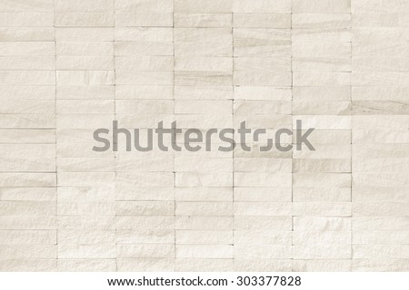 Rock stone tile wall texture rough patterned background in white cream color tone: Limestone finishing textured backdrop for interior decoration and design in light white creme brown toned colour    - stock photo