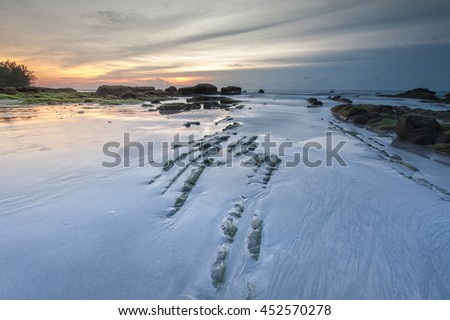 rock stripe on the beach at kudat sabah malaysia. image may contain soft focus and blur,