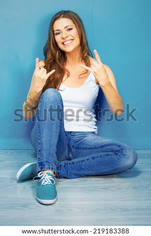 Young Handsome Teenager Sitting On Floor With Book And Rucksack And