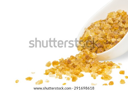 Rock sugar from sugar cane in white cup isolated on white background with clipping path. - stock photo