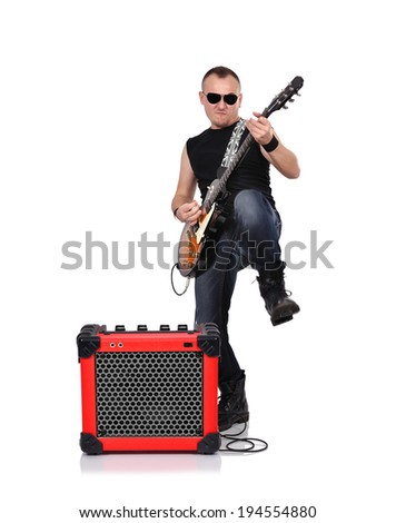 rocker with electrical guitar on a white background - stock photo