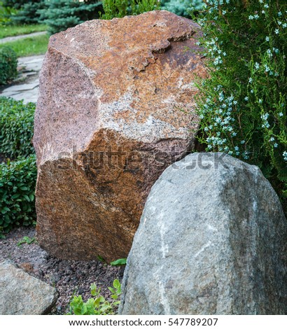 Rockery With Big Stones And Different Evergreen Plants (oriental Thuja,  Boxwood) In The