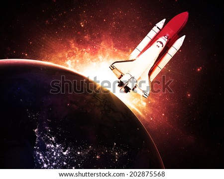 Rocket Against Gold Sunset - Elements of this Image Furnished By NASA - stock photo