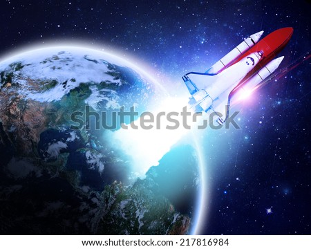 Rocket Flying Away From Earth - Elements of this Image Furnished By NASA - stock photo
