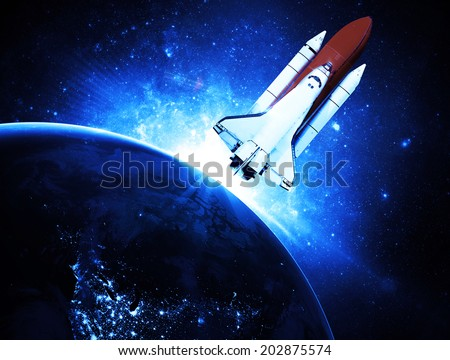 Rocket Leaving Earth - Elements of this Image Furnished By NASA - stock photo