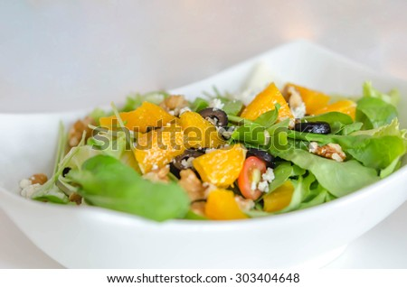 rocket salad with Parmesan cheese and orange fruit