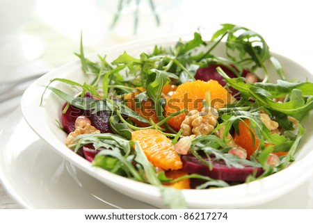 Rocket with orange and beetroot salad - stock photo