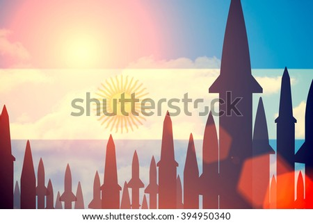 Rockets silhouettes background Argentine flag. Toned - stock photo