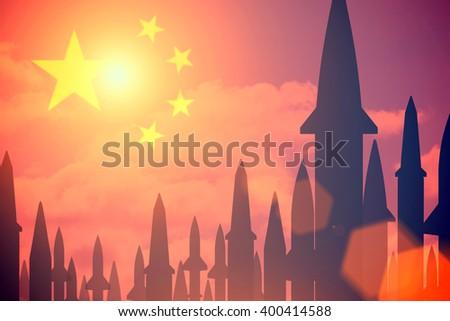 Rockets silhouettes background China flag. Toned - stock photo