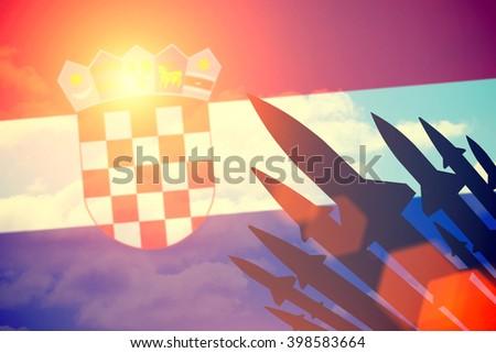 Rockets silhouettes background Croatia flag. Toned - stock photo