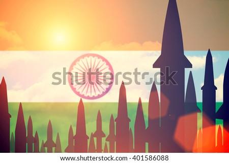 Rockets silhouettes background India flag. Toned - stock photo