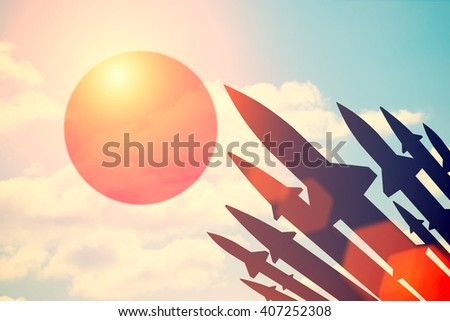 Rockets silhouettes background Japan flag. Toned - stock photo