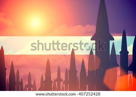 Rockets silhouettes background  Latvia flag. Toned - stock photo