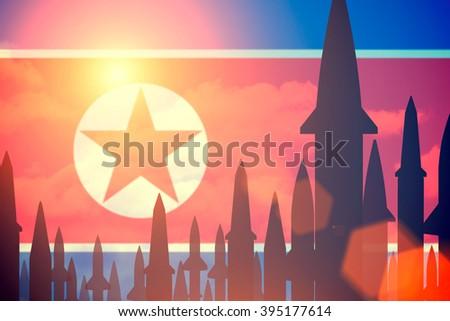 Rockets silhouettes background North Korea flag. Toned - stock photo