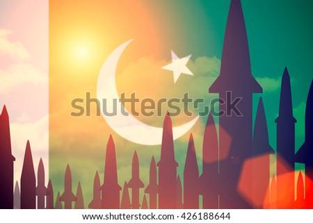 Rockets silhouettes background Pakistan flag. Toned - stock photo