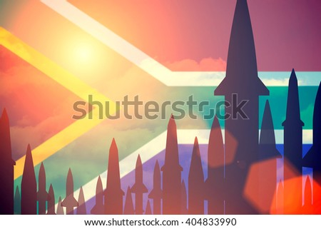 Rockets silhouettes background South Africa flag. Toned - stock photo