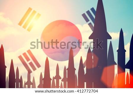 Rockets silhouettes background South Korea flag. Toned - stock photo