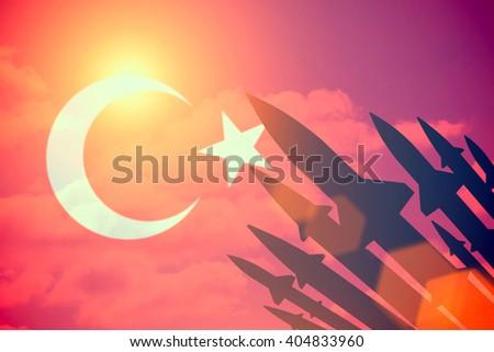 Rockets silhouettes background Turkey flag. Toned - stock photo