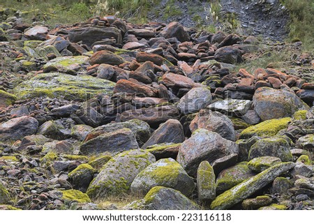Rockfall pile in the Glacial Valley, Fox Glacier, Westland Tai Poutini National Park, South Island, New Zealand. - stock photo