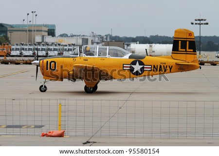 ROCKFORD, IL - JULY 31: Single engine propeller plane in preparation of taking off at the annual Rockford Airfest on July 31, 2010 in Rockford, IL - stock photo