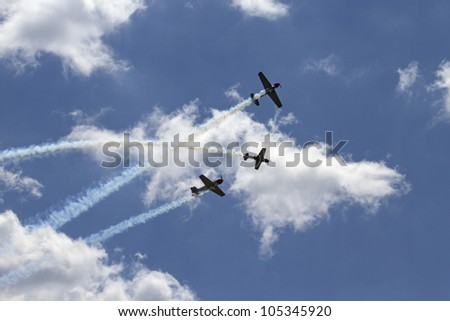 ROCKFORD, IL - JUNE 3: Airplane formation from the Aerostars team demonstrates flying skills and aerobatics at the annual Rockford Airfest on June 3, 2012 in Rockford, IL