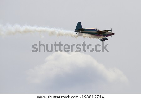 ROCKFORD, IL - JUNE 7: Airplanes from Team Firebirds demonstrates flying skills and aerobatics at the annual Rockford Airfest on June 7, 2014 in Rockford, IL