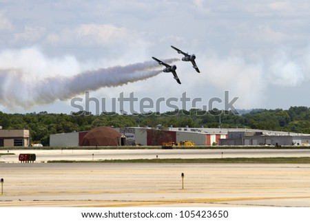 ROCKFORD, IL - JUNE 3: Black Diamond Jet Team with MiG-17 demonstrates flying skills and aerobatics at the annual Rockford Airfest on June 3, 2012 in Rockford, IL - stock photo