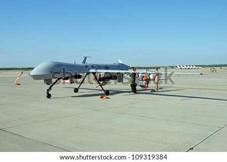ROCKFORD, IL- JUNE 2: MQ-1 Predator Drone being rolled into position as a static display on June 2, 2012 for the Rockford AirFest in Rockford, IL. - stock photo