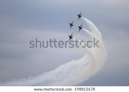 ROCKFORD, IL - JUNE 7: U.S. Air Force Thunderbirds fighter jets demonstrate flying skills at the annual Rockford Airfest on June 7, 2014 in Rockford, IL - stock photo