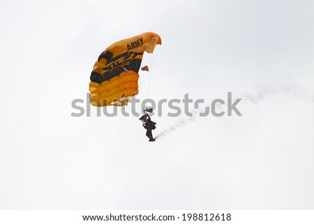 ROCKFORD, IL - JUNE 7: U.S. Army Golden Knights Parachute Team demonstrates flying skills at the annual Rockford Airfest on June 7, 2014 in Rockford, IL - stock photo