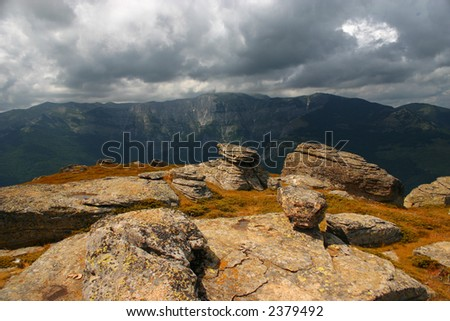 Rockie terrain with heavy clouds in background - stock photo