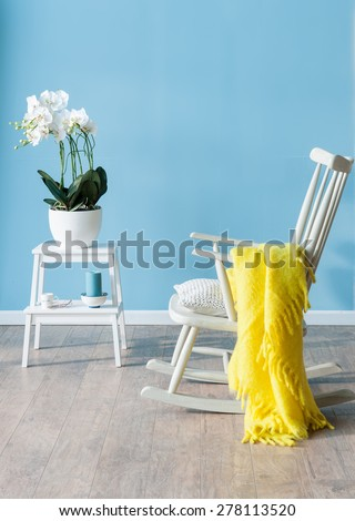 rocking chair with flower - stock photo