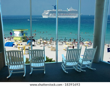 Rocking Chairs By Window Overlooking Scenic Stock Photo - Rocking cruise ship