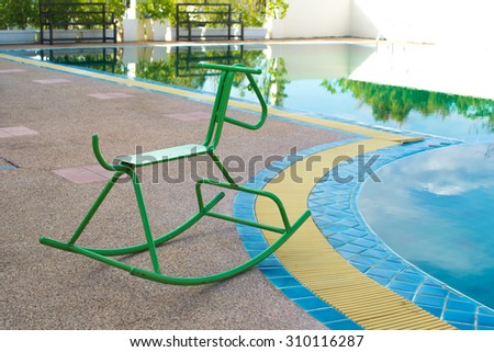 Rocking Horse beside the pool