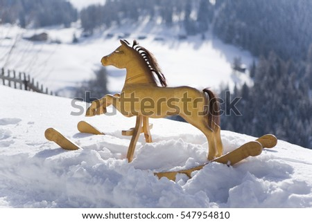 rocking horse in snow
