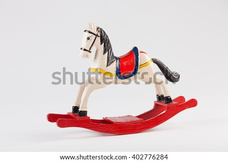 Rocking wooden toy horse on white background