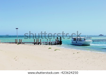 ROCKINGHAM, WESTERN AUSTRALIA - November 25. Ferry boat in the Indian Ocean arrives from Penguin Island at the jetty on November 25, 2015 in Rockingham.  - stock photo