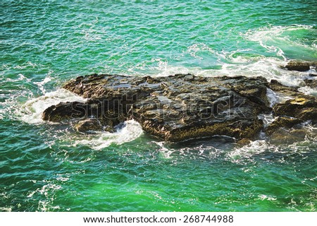 rocks along the beach, Andaman Sea, Thailand - stock photo