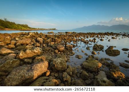 Rocks along the coast at low tide. - stock photo