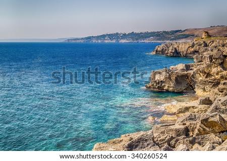 Rocks and architecture of the coast of Salento of the Ionian Sea in Italy,  in Santa Cesarea Terme, Lecce, Apulia - stock photo