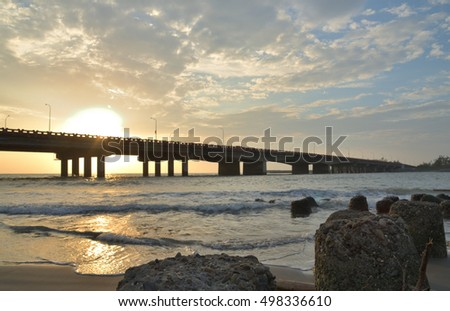 rocks and bridge at sunset