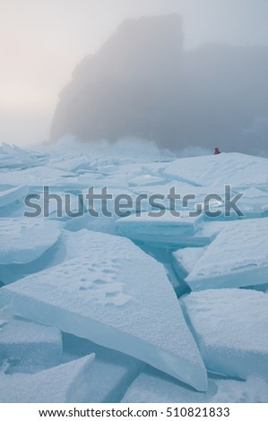 Rocks and field of ice siberian Baikal Lake in winter