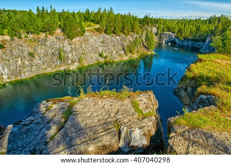 Rocks and Limestone Cliffs in Ruskeala Park of Karelia, Russia - stock photo