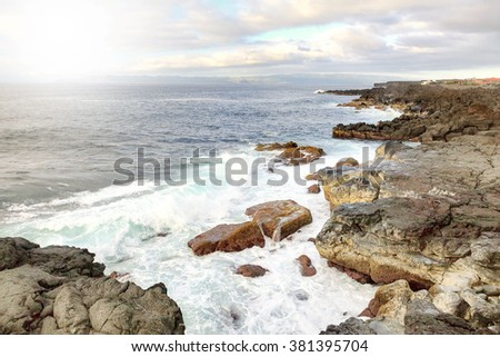 Rocks and ocean waves in Azores, Portugal - stock photo